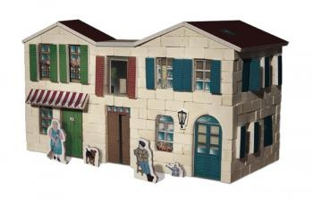 Construction kit with real bricks of a mediterranean house. The building blocks can be reused because the cement is dissolved in water. Contains: construction bricks, cement , wood building components, spatula, bowl, plate and a foam board with figures.