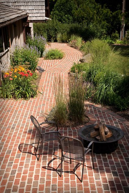 Linking the garden to the house through brick has been turned on its head in this garden. The vivid brick paving and almost exaggerated light mortar create a path that's tied to the house but also create interest where the paving deviates.