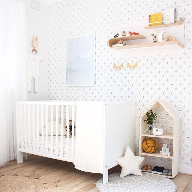 Calming neutral nursery with pops of mustard yellow. White crib. Peel and stick black and white geometric wallpaper  #kidsinterior #kidsdecor #kidswallpaper #nurserydecor #nurserywallpaper #nurseryinspo #nursery #wallpaper #selfadhesivewallpaper #removablewallpaper
