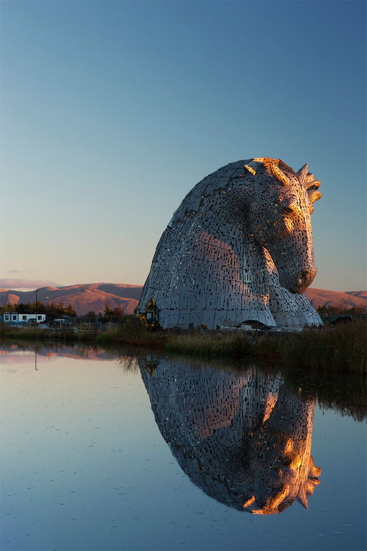 Giant Kelpies Horse Head Sculptures Tower Over the Forth & Clyde Canal in Scotland.