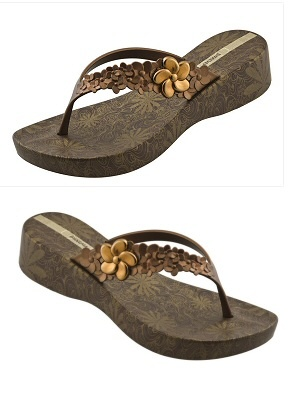 Brown wedge flip flop with metallic bronze floral design on wedge and metallic bronze straps with floral detail by Ipanema Flip Flops, $38.00