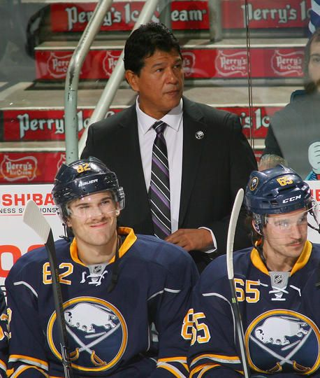 Marcus Foligno #82 Brian Flynn #65 and Buffalo Sabres head coach Ted Nolan