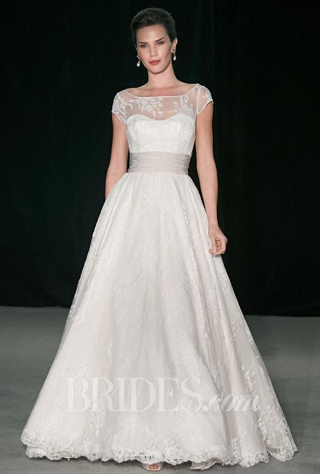 Brides.com: . Lace A-line wedding dress with an illusion bateau neckline and cap sleeves, Anne Barge