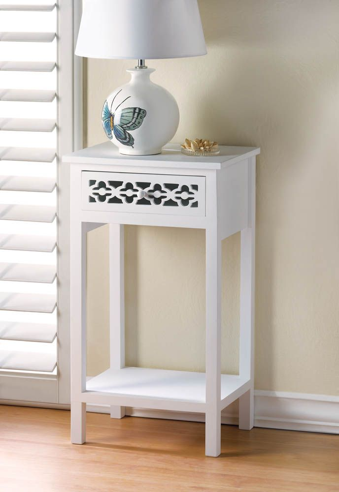 10015873 MEADOW LANE SIDE TABLE The elegant and classic design of this wooden side table gets a splash of show-stopping style from the die-cut pattern of the pullout drawer.