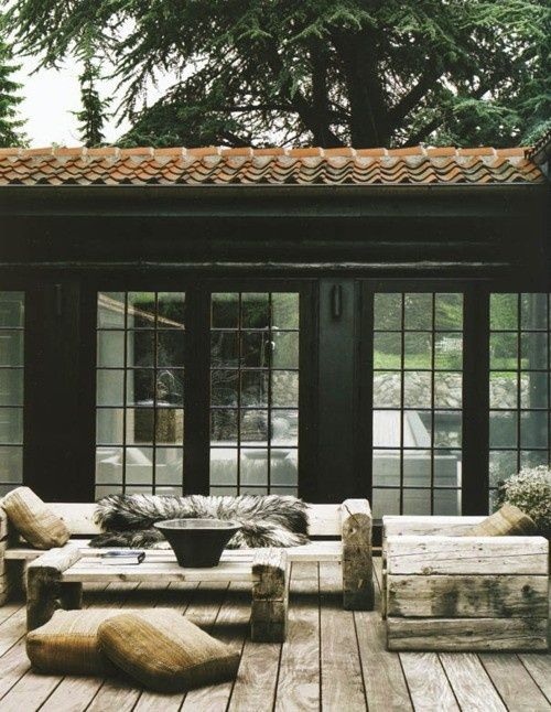 rustic and raw outdoor furniture- that somehow works well with this house...