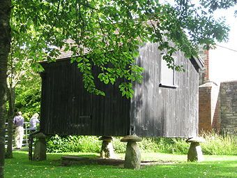 A building sitting on staddle stones, at the Somerset Rural Life Museum