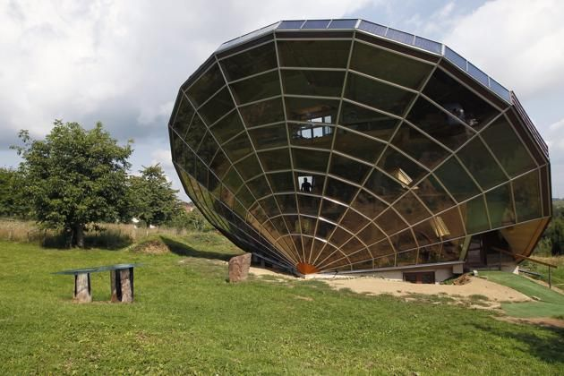 The Heliodome, a bioclimatic solar house is seen in Cosswiller in the Alsacian countryside near Strasbourg, Eastern France, August 4, 2011. The house is designed as a giant three-dimensional sundial, set on a fixed angle in relationship to the sun's movements to provide shade during the summer months, keeping the inside temperature cool, and during Fall, Winter and Spring sunlight enters the large windows as the sun's position is lower in the sky, thus warming the living space