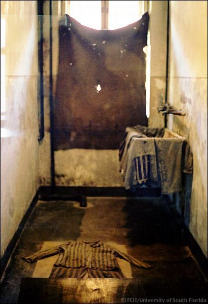 "A washroom in Block 11--the ""Death Block."" Here condemned prisoners were made to undress before being shot."