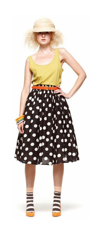 Black skirt with white polka dots. Mix it up with striped socks