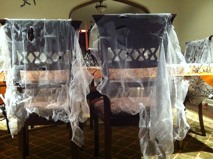 cut random wholes in cheese cloth for fun spider web chair decorations for halloween - Cheesecloth Halloween Decorations
