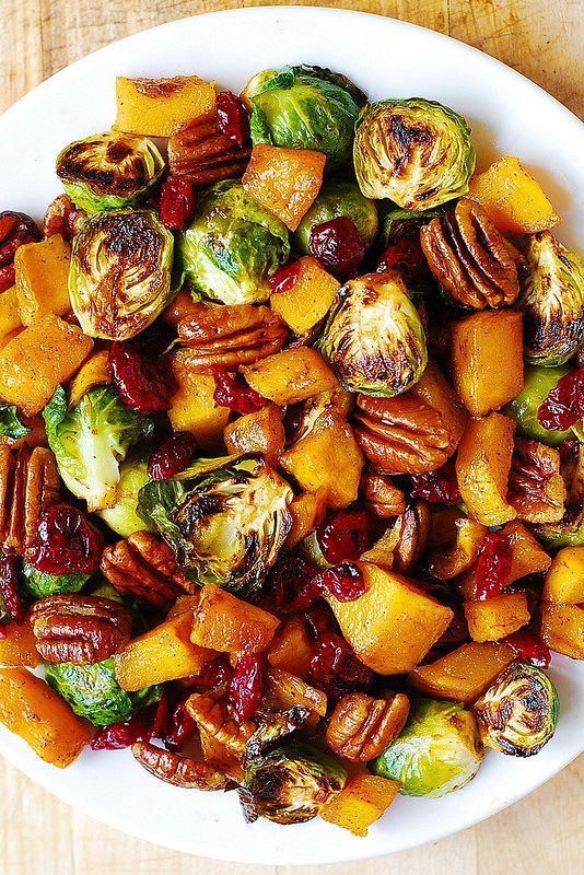 Roasted Brussels sprouts with butternut squash, pecans, and cranberries.
