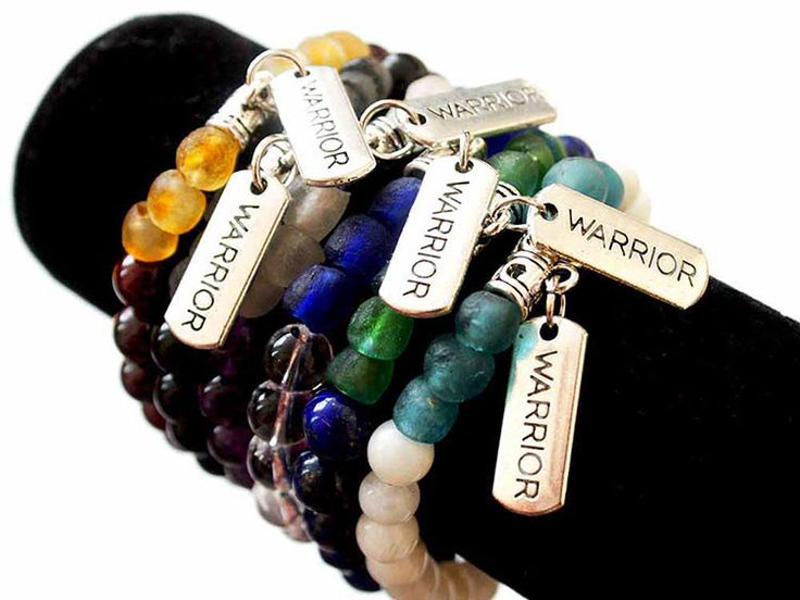 Warrior Bracelet. Made with genuine semi-precious stone, recycled glass beads & Warrior charm.  Recycled glass fair trade beads are handmade in Ghana Africa. The beads we purchased directly support bead artisan located in Ghana & WFTO's goal ' to create sustainable business for traditional African artisans'