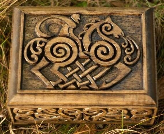So cool!  A wooden box with Sleipnir carved on the top.  Sleipnir is Odin's eight legged horse that carries him from the world of the Gods to the world of men.