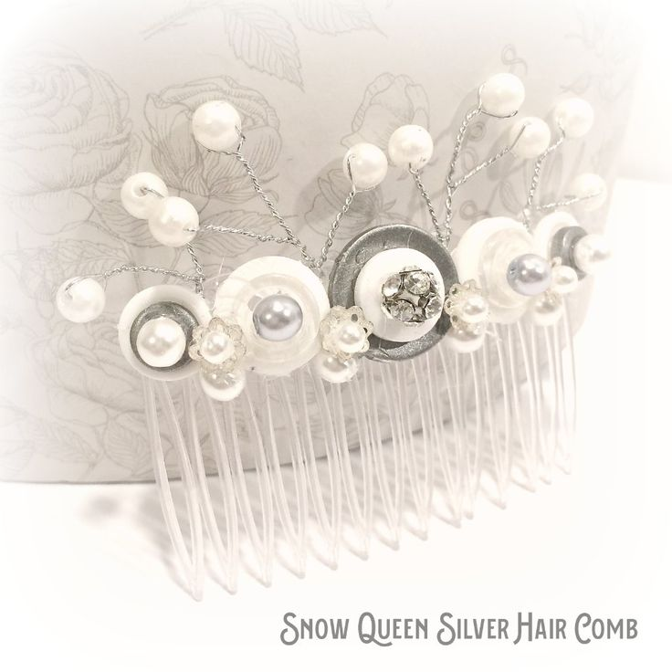The snow queen hair comb is embellished with white and silver buttons and pearl effect beads in white and silver. Complements your wedding hair beautifully