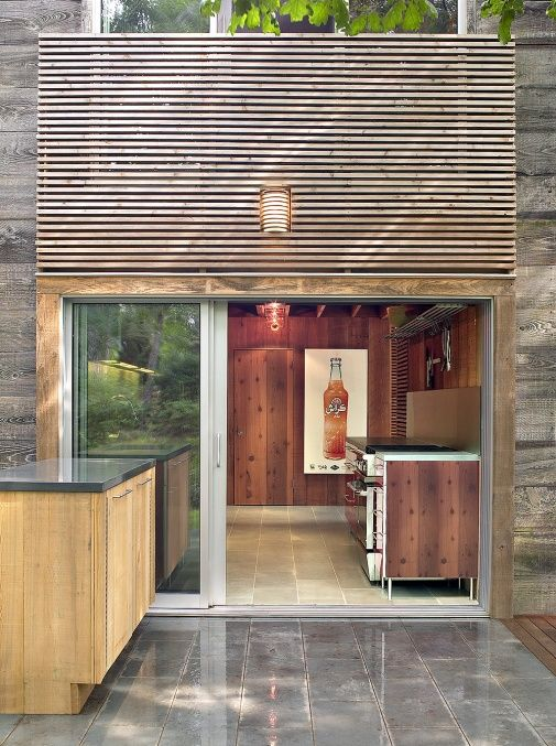 Bates Masi, looking into kitchen from back patio. A Midcentury Cabin in Amagansett by Christine