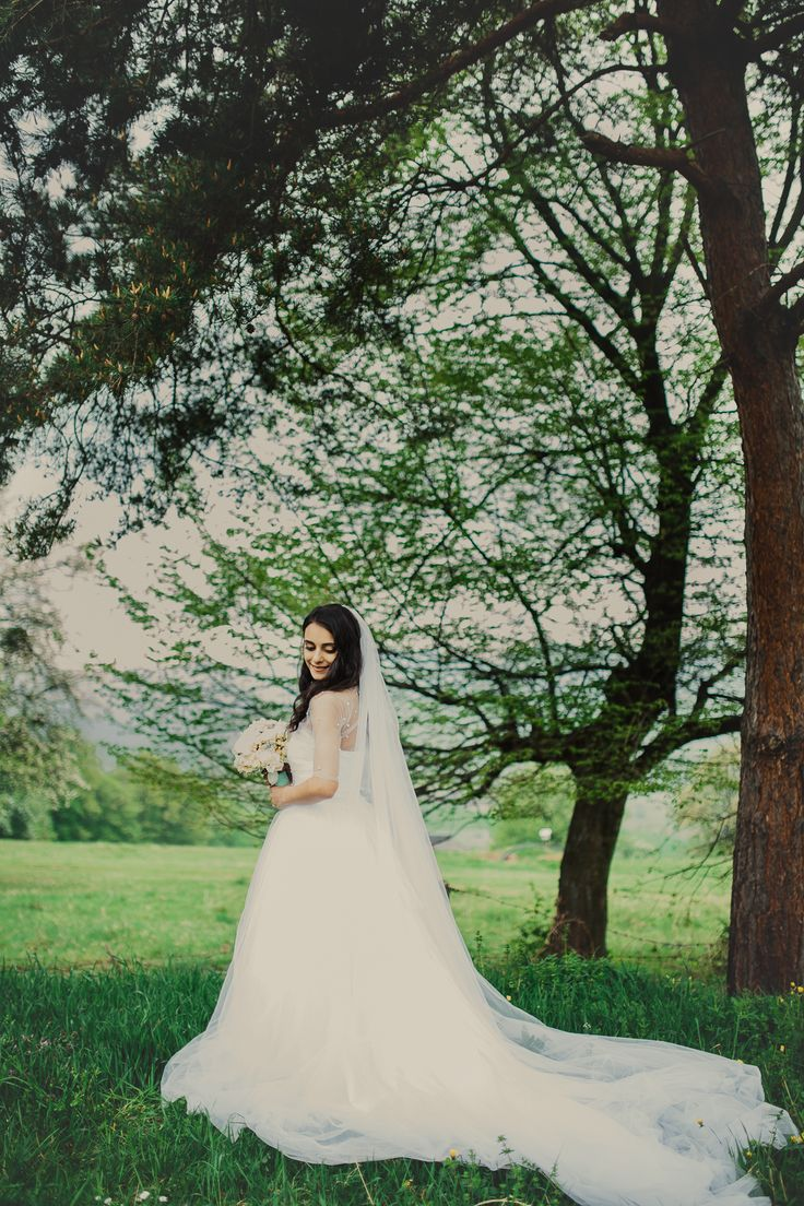 Tulle wedding dress with train and long veil