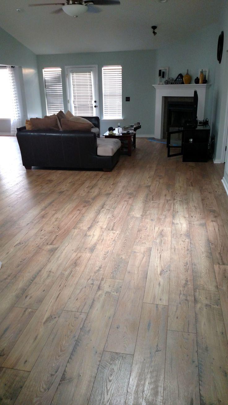 Elegant Pergo Flooring In Basement