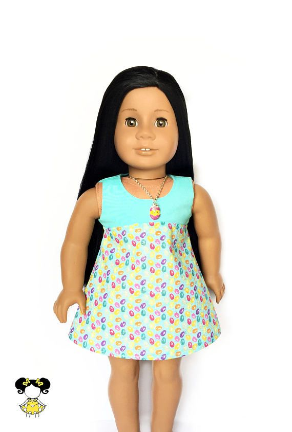 Easter sleeveless dress, perfect for 18 inch dolls! The dress features a high waist turquoise blue, pink, yellow and purple Easter egg print skirt and a turquoise blue bodice with a Velcro closure in the back. Item is handcrafted in our smoke free, pet free studio. • Listing includes