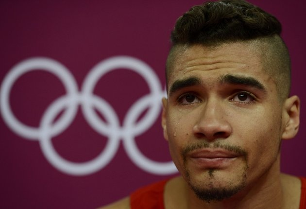 Louis Smith of Great Britain cries during the men's gymnastics qualification in the North Greenwich Arena during the London 2012 Olympic Games July 28, 2012. (REUTERS/Dylan Martinez)