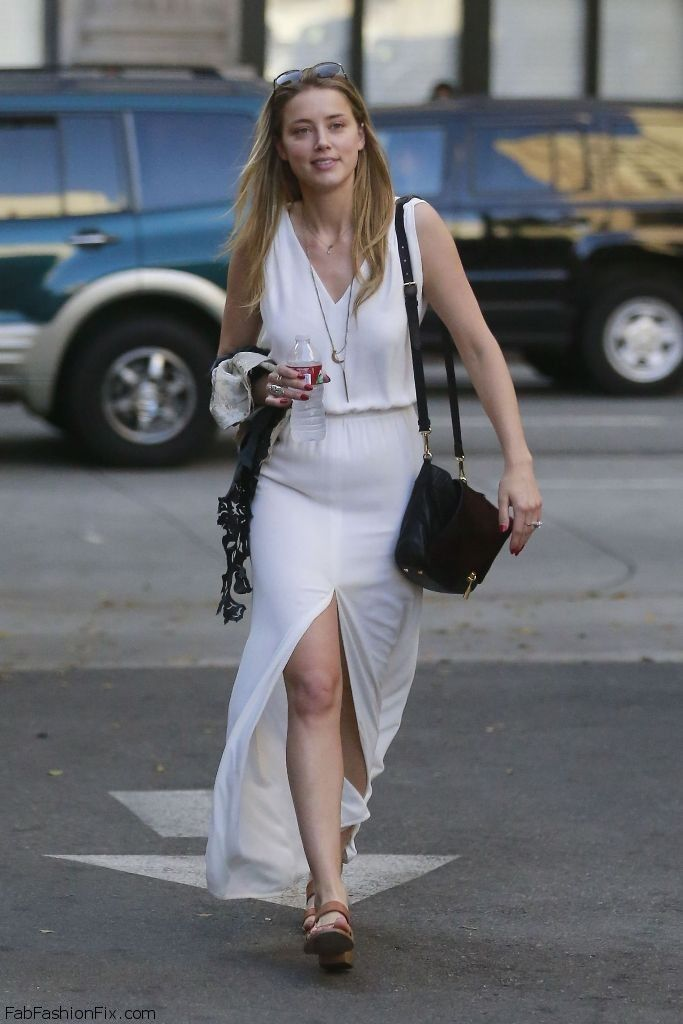 Amber Heard summer street style with white maxi dress.