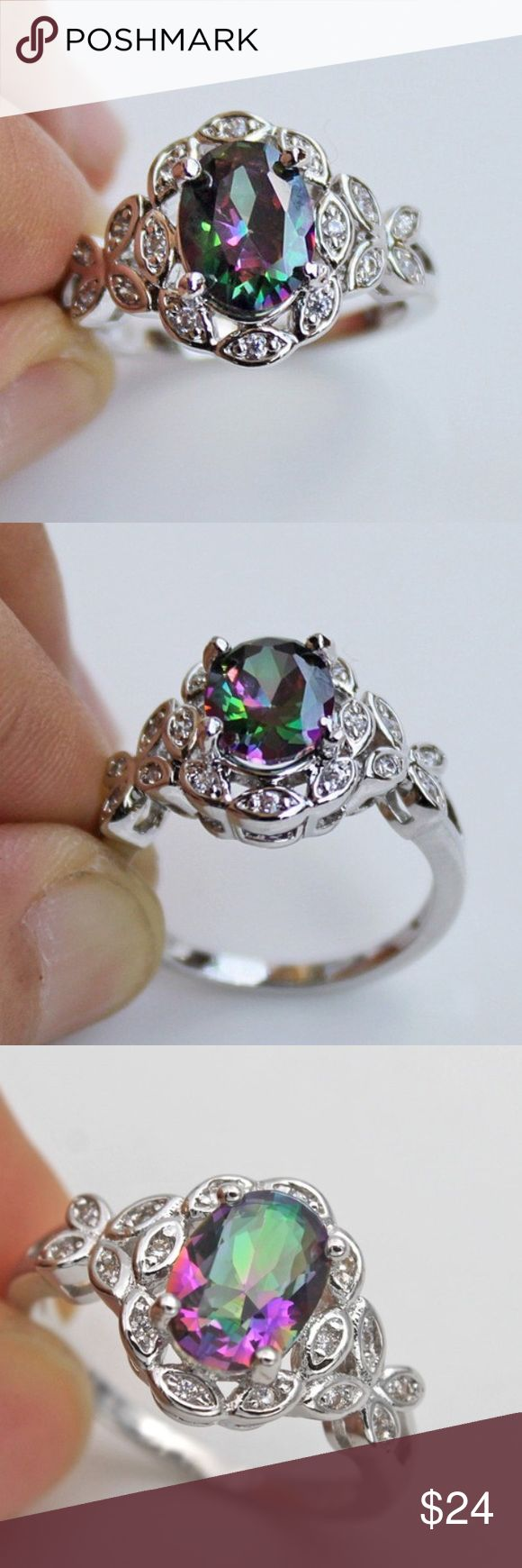18k white gold ring mystical topaz new 18k white gold filled ring mystical topaz new . This ring is so sparkly and gorgeous . It's has colors of purple and green Jewelry Rings