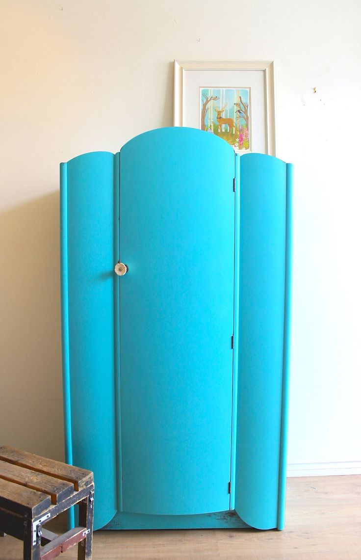 Art Deco Armoire. Someone painted the beautiful woodwork blue, but someone else will recover the wood...