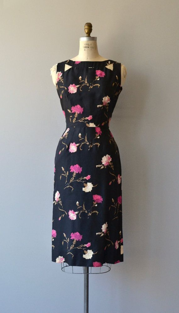 Vintage 1950s Saks Fifth Avenue black silk sheath dress with pink carnation print, cutout shoulders at front and back, fitted waist and metal zipper. --- M E A S U R E M E N T S --- fits like: small bust: 36-37 waist: 26 hip: up to 37 length: 44.5 brand/maker: Saks Fifth Avenue condition: excellent ✩ layaway is available for this item To ensure a good fit, please read the sizing guide: http://www.etsy.com/shop/DearGolden/policy ✩ more vintage dresses ✩ http://www.etsy.com/shop/DearGolden...