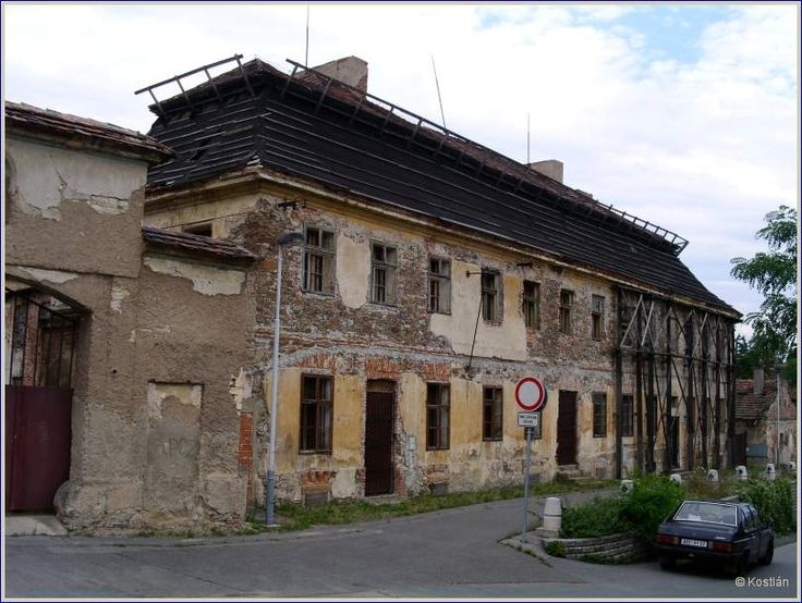"""Unfortunately this building, also close to the river, really shows its age. It was part of the """"Statek"""" where a lot of farming was done, and it also housed the post office. We used to go there all the time, sending letter, parcels ..."""