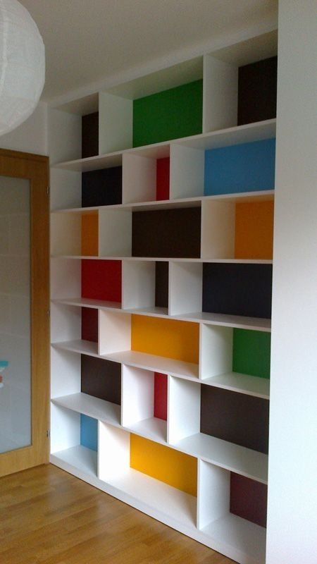 "Huge ""built-in"" floor to ceiling shelf with bright colors painted behind it"