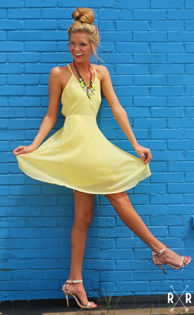 this lemon yellow dress is perfect for any special occasion this summer with an empire waist line and a flowy skirt. features cross straps on the back (that are adjustable!) and a v-neckline for a perfect fit.