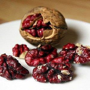 "Red walnuts  Rex Lawrence of Sanguinetti Family Farms in California tells us how these stunners came to be: ""They are not genetically modified. They were created using natural methods of grafting Persian, red-skinned walnuts onto the larger and creamier English walnuts."" Born on slower-growing trees, red walnuts are larger and the shells are a little harder than other walnut varieties. Available at the end of fall and into the winter."