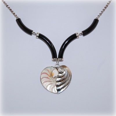 Buffalo horn, with a half nautilus half sterling silver heart. Entirely handmade in our workshop.
