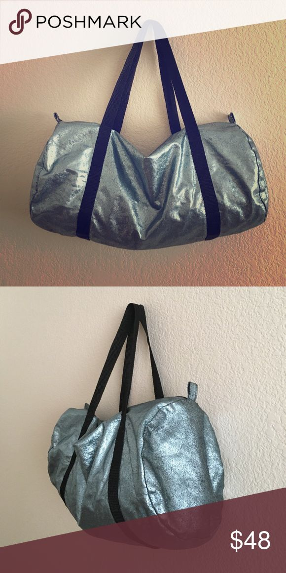American Apparel Duffel Light blue metallic American Apparel duffle bag with black straps. A few hardly noticeable scratches on bottom. American Apparel Bags Totes