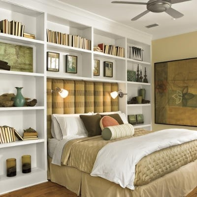 built-in bookshelves around the bed Half this height - bathroom behind..??