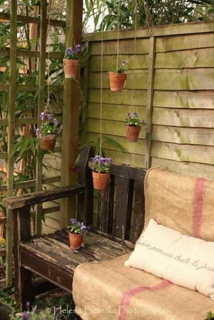 colgando diseño de jardines con pequeños plantadores