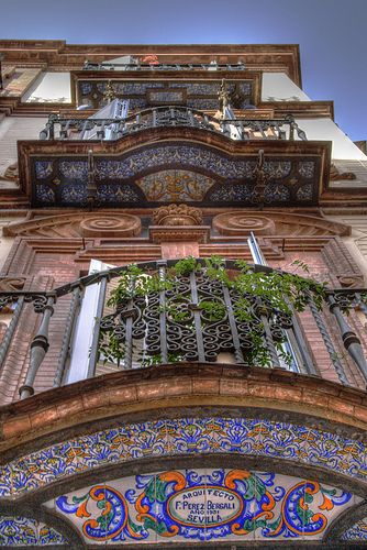 Sevillian balcony in Seville, Spain  ✈✈✈ Don't miss your chance to win a Free International Roundtrip Ticket to Seville, Spain from anywhere in the world **GIVEAWAY** ✈✈✈ https://thedecisionmoment.com/free-roundtrip-tickets-to-europe-spain-seville/