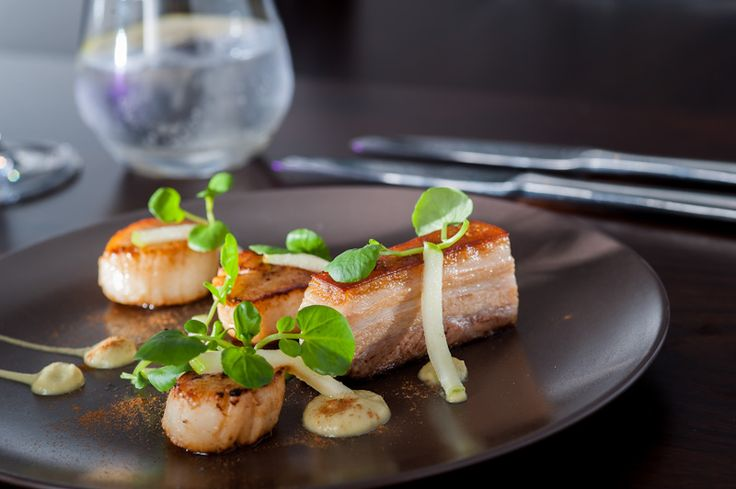 Pork-belly-with-scallops-on-place-setting