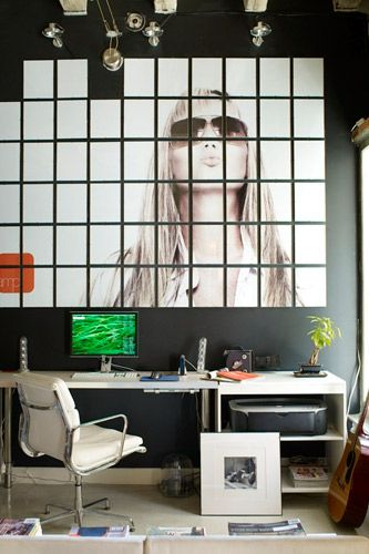 """""""Not everything should be small or space-saving. Big objects or pieces of art can add drama and expansiveness to a small space. By playing against the size of this one bedroom loft space in L.A. with a huge DIY photographic mural, this room feels more spacious than it is."""""""