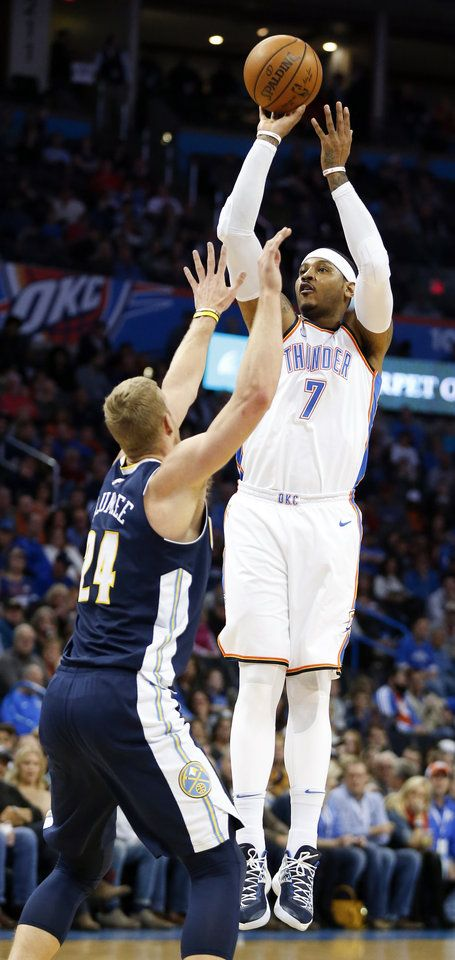 Oklahoma City's Carmelo Anthony shoots as Denver's Mason Plumlee defends during Monday's game at Chesapeake Energy Arena in Oklahoma City. The Thunder won, 95-94. [Photo by Nate Billings, The Oklahoman]