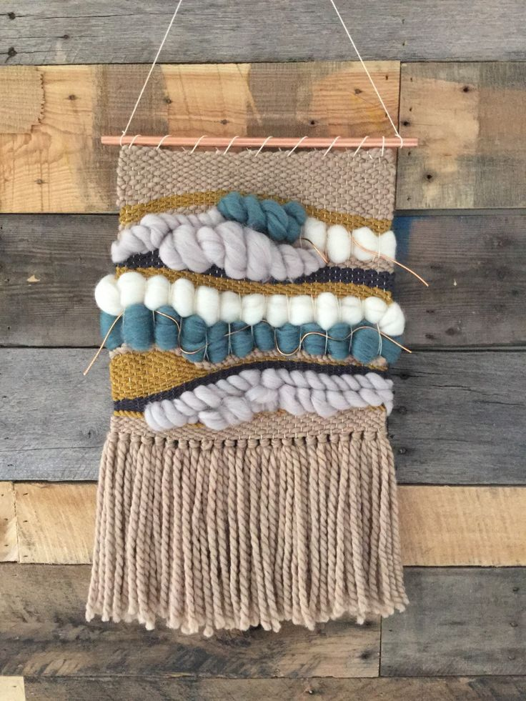 A personal favorite from my Etsy shop https://www.etsy.com/listing/229641980/handmade-woven-wall-hanging