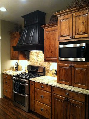 Rustic knotty alder kitchen cabinets.