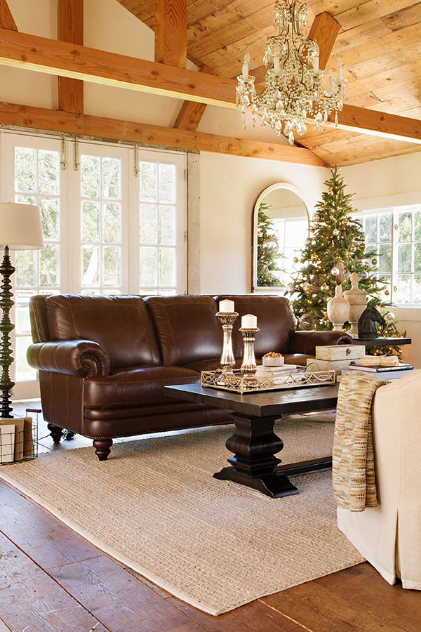 The elegant churchill collection boasts leather cushions with box stitching and nailhead trim delivering a
