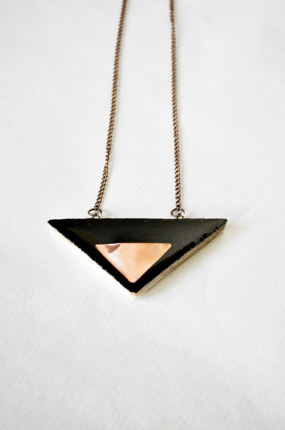 Check out this item in my Etsy shop https://www.etsy.com/listing/220361753/black-necklace-with-triangle-wooden