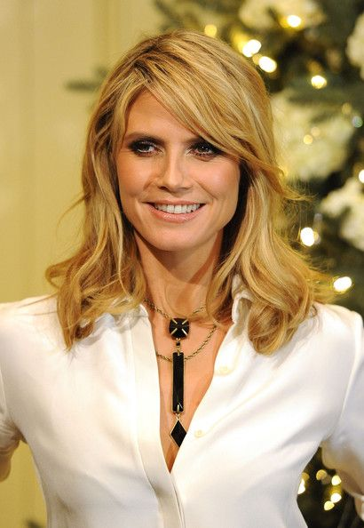 Heidi Klum attended a QVC shopping event wearing a shiny peachy-beige lipstick.