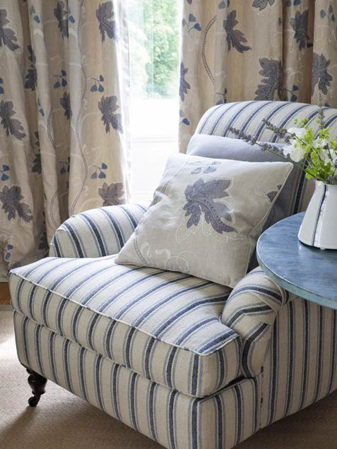 Colefax & Fowler...ticking stripe rolled arm chair, 1-877-229-9427 www.eadeswallpaper.com #interior #decor #home #fabric
