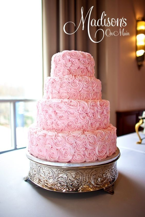 This has been a hot design this year, and I really love the way this cake looks in person.  You cant see in the photo, but it was covered in rainbow disco dust...and it sparkled like a diamond!  :)  Photo by Kevin Paul Photography.