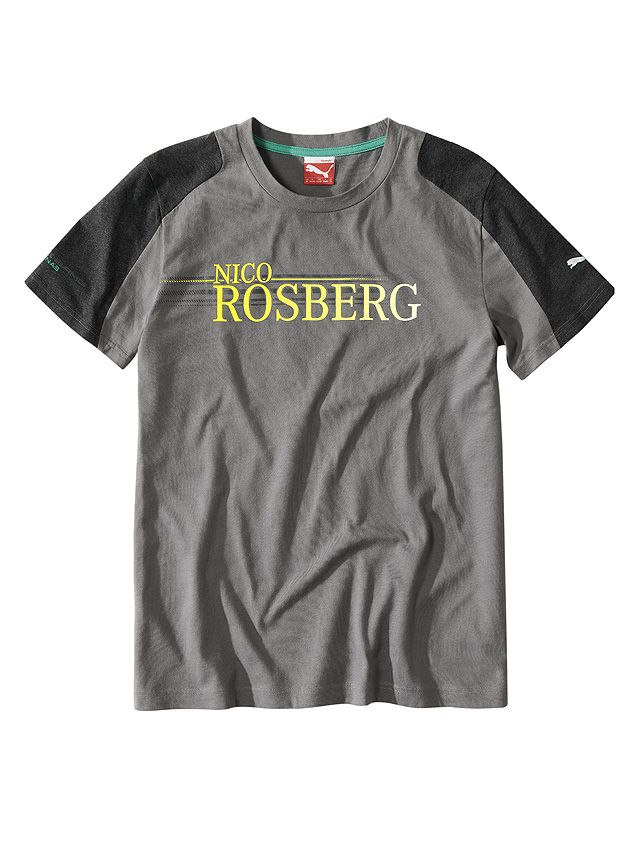 Part number:     B67995223  Show your colours: the large yellow Nico Rosberg lettering on this T-shirt leaves no doubt about where your allegiances lie.  The grey T-shirt is produced in cotton and features anthracite-coloured sleeve/shoulder panels.  Colour: grey 100% cotton Mercedes-Benz logo print on nape MERCEDES AMG PETRONAS logo print on right sleeve PUMA Cat logo print on left sleeve