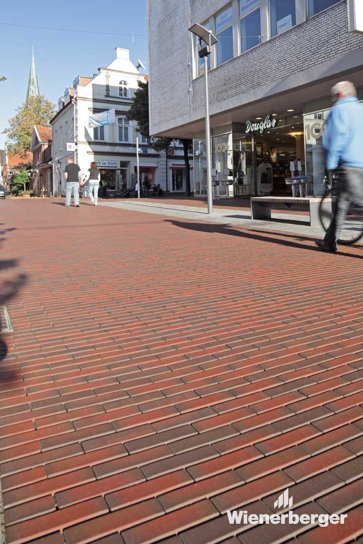 An interesting visual interplay was intentionally created with the use of bright red fired clay pavers, and by running them in different directions.