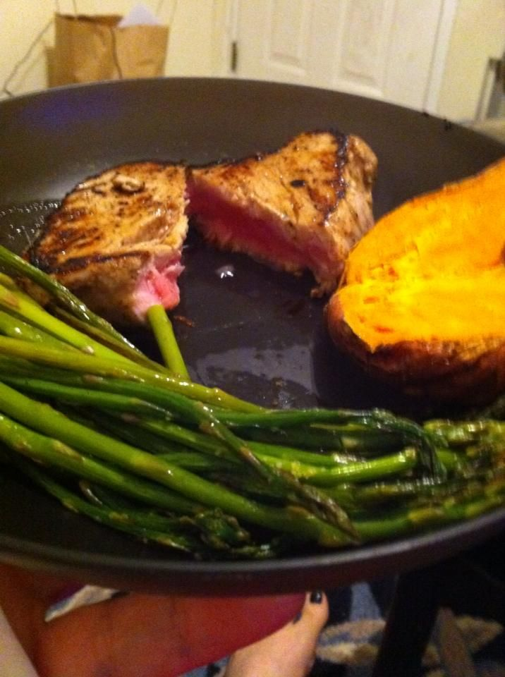 """This is one of my """"treat"""" meals on my diet: pan seared tuna with roasted asparagus and a baked sweet potato. Yum. Healthy never tasted so good."""