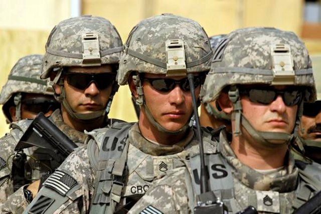A picture from the US Army. The army is a male dominated profession due to its tough physical requirements and on the job duties. The ideal person is that who fits hypermasulinity traits. One who is big, strong, aggressive, and is up for a fight